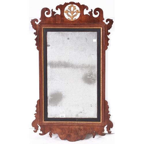 1415 - A Victorian walnut and giltwood fretwork mirror, 98 x 57cm
