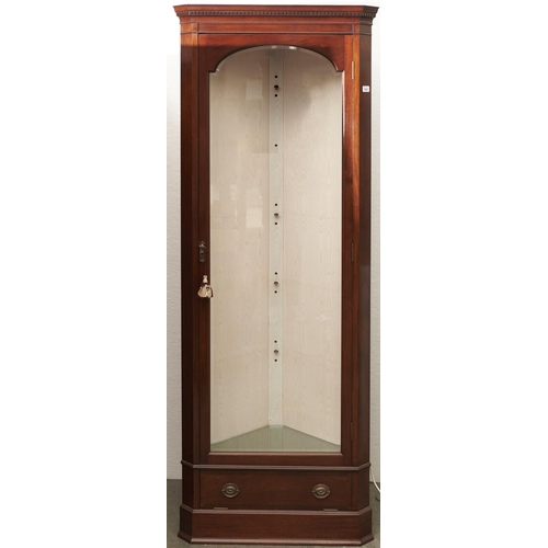 1423 - A reproduction mahogany standing corner cupboard, third quarter 20th c, the arched bevelled glazed d...