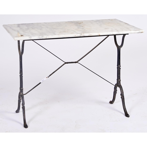 1433 - A cast iron table, the rectangular frame on two warped end supports, with marbletop, 74cm h; 59 x 9...