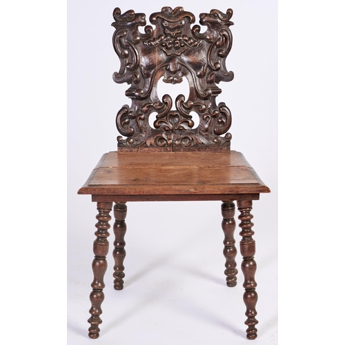 1446 - A Victorian carved walnut hall chair, with boarded seat on bobbin turned legs, seat height 43cm...