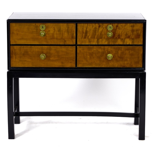 1486 - A Danish stained birch and ebonised four drawer cutlery canteen, Fritz Hansen 1938, with brass knobs...