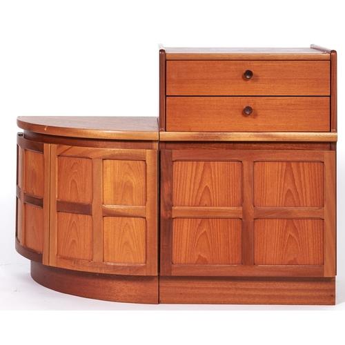 1491 - A teak veneered corner base unit, enclosed by a pair of four panel bowed cupboard doors on inset pli...