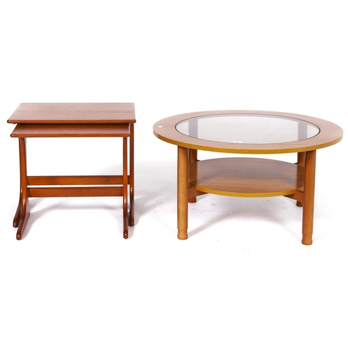 1496 - A Schreiber teak coffee table, c1970's, with inset glass centre, 44cm h x 85cm diam and a contempora...