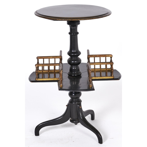 1520 - A Victorian ebonised revolving book table, c1870, with painted drab detail to the top and gallery, 7...
