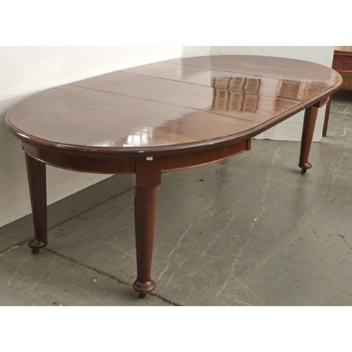 1533 - A mahogany extending dining table, c1920's, the oval ended top with moulded lip above a shallow apro...