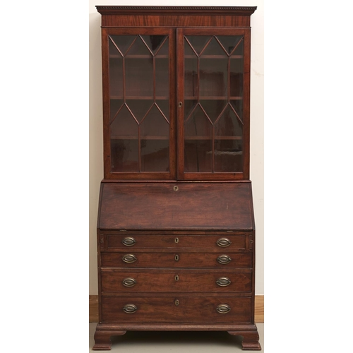 1548 - A George III mahogany bureau-bookcase, early 19th c, the bureau with fitted interior, on ogee feet, ...