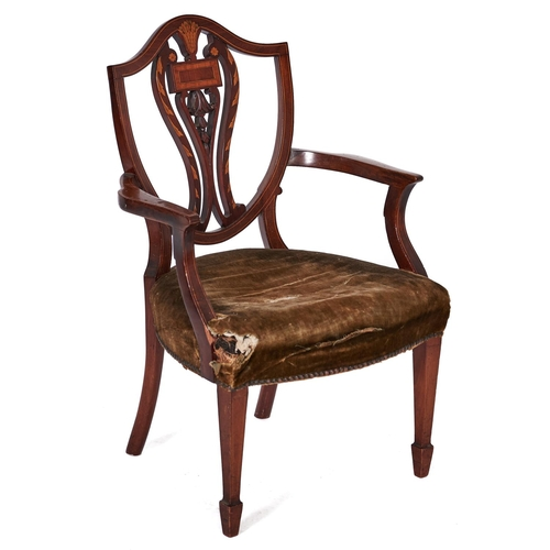1560 - A mahogany and inlaid dining chair, English or Dutch, 19th c, the shield shaped back with carved spl...