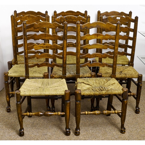 1573 - Eight stained ash ladder back chairs, early 20th c, rush seated, seat heights 45cm and circa...