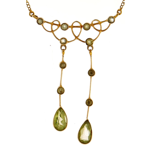 185 - A peridot negligee necklet, in gold marked 15ct, 3.7g
