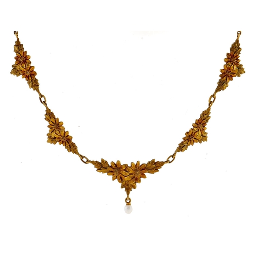 186 - A gold necklace with seed pearl drop, 6.7g