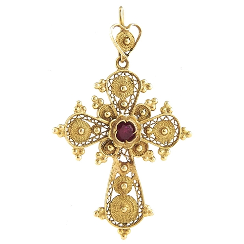 193 - A gold filigree cross set with a synthetic ruby, marked 18k, 2.2g