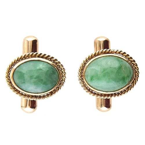 195 - A pair of South East Asian gold and jade cuff links, marked 14k, 8.3g
