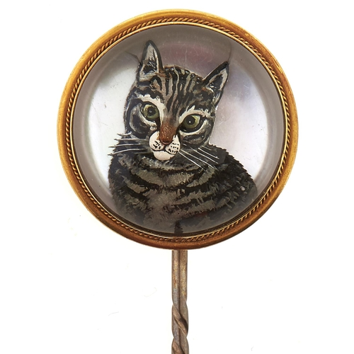 198 - A Victorian reverse painted intaglio or 'Essex' crystal cat stick pin, in gold marked 18, base metal...