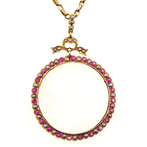 221 - A ruby, split pearl and gold locket, marked 9ct and a gold necklet marked 9c, 8g excluding glass...