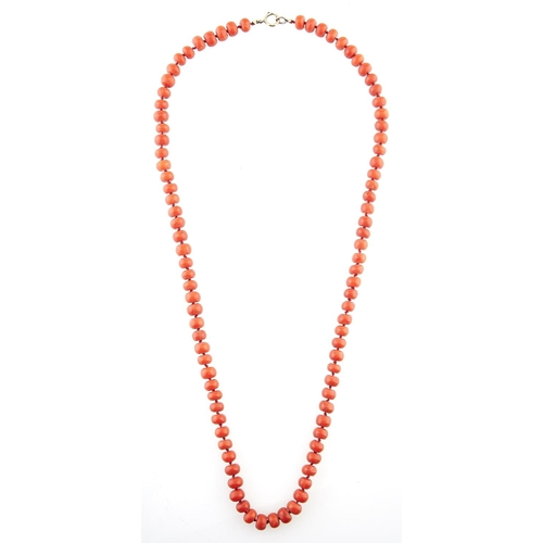 223 - A coral bead necklace with probably later gold clasp, 6.9g