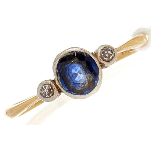 23 - A diamond and sapphire ring, in gold marked 18, 1.8g, Size N
