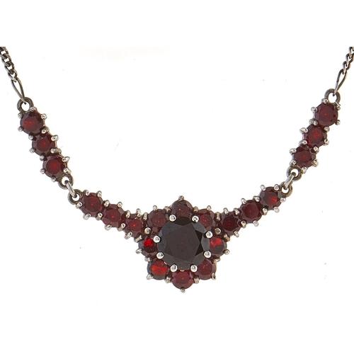 239 - A garnet and silver necklet, 5g