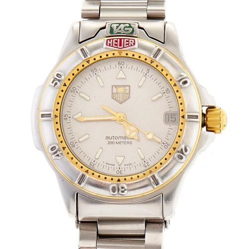 255 - A Tag Heuer stainless steel self-winding wristwatch,screw down crown, Tag Heuer bracelet, No 69571...