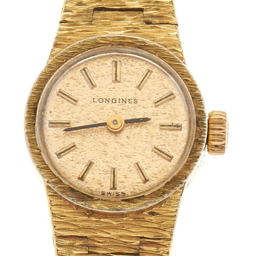 271 - A Longines gold plated lady's wristwatch, with textured tapered bracelet, stainless steel back, box ...