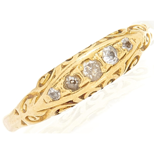 31 - A five stone diamond ring, in gold marked 18, 3.6g, size M