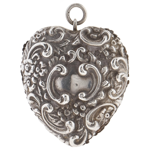 311 - A Victorian heart shaped silver pin cushion, embossed scrolls, flowerheads and leafage, 2.4 x 4.5cm,...