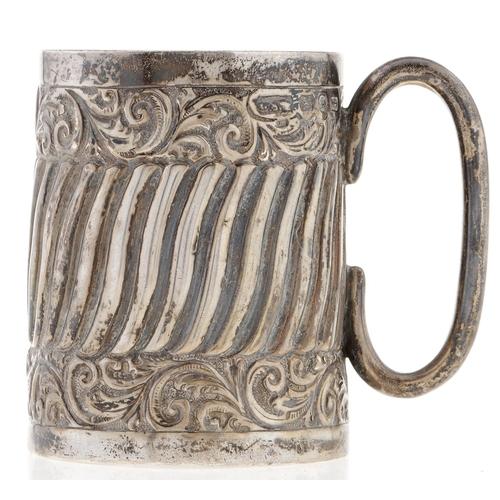 312 - A Victorian silver christening mug, spiral fluted within foliate scroll bands, 6.5cm h, Birmingham 1...