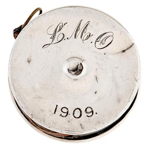 334 - An Edwardian silver tape measure, 35mm diam, Birmingham 1909
