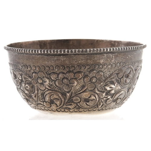 352 - A South East Asian silver repousse sugar bowl, early 20th c,95mm diam, 2ozs