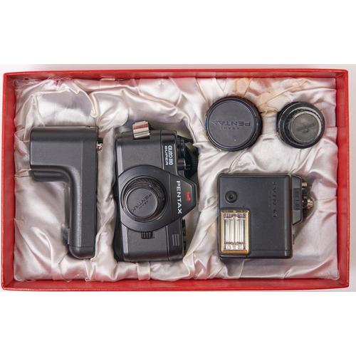 402 - A Pentax Auto 110 Super Camera outfit, comprising Pentax Auto 110 Super Camera, Pentax-110 24mm F2.8...