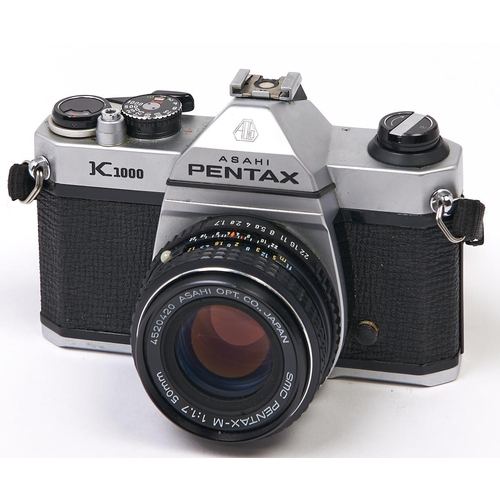 413 - A Pentax K1000 SLR camera, with SMC Pentax-M 50mm F2 lens