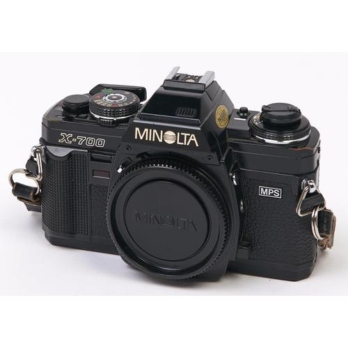 424 - A Minolta X-700 MPS SLR 35mm camera body, with body cap and Minolta cap