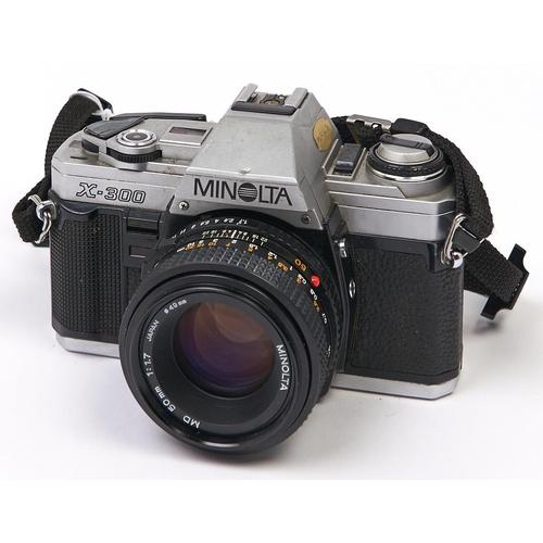 432 - A Minolta X-300 SLR 35mm camera, with Minolta MD 50mm F1.7 lens, Minolta case