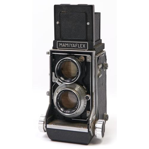 462 - A Mamiyaflex C2 twin lens reflex medium format camera, with Mamiya-Sekor 105mm F3.5 lenses and caps...