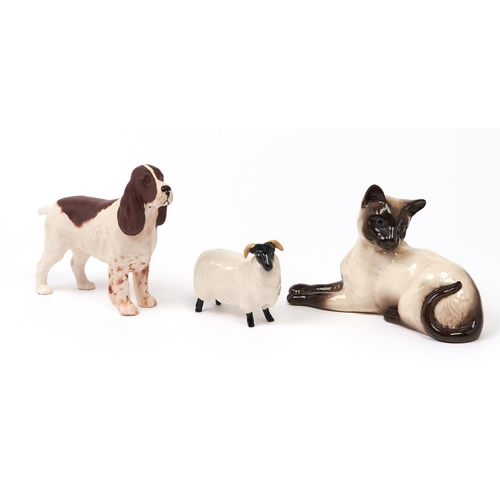484 - Three Beswick animals in the form of a spaniel, matt glaze, a Siamese cat and a ram