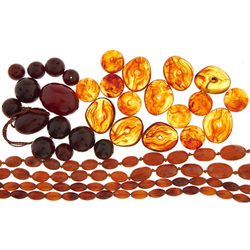 595 - Two necklaces of amber beads, miscellaneous irregular shaped amber beads and an unstrung necklace of...