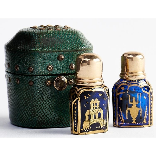 619 - A pair of English gold capped blue glass scent bottles and shagreen case, the gilding possibly by Ja...