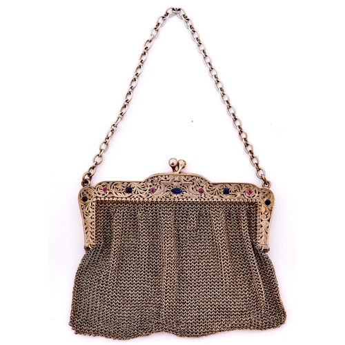 646 - A French paste set silver gilt and chainmail bag, the frame finely pierced and engraved with scrolli...