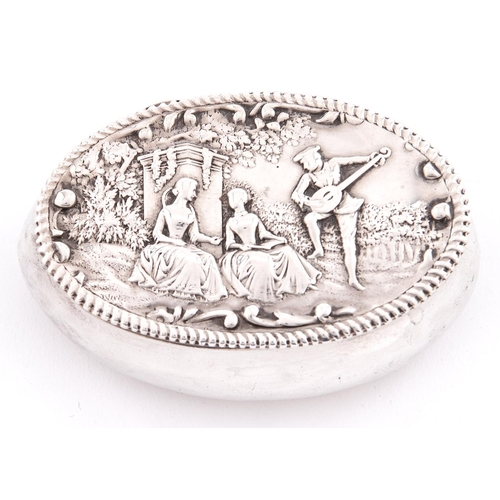 649 - A Victorian oval silver bombe trinket box, the lid embossed with ladies and musician, in beaded bord...