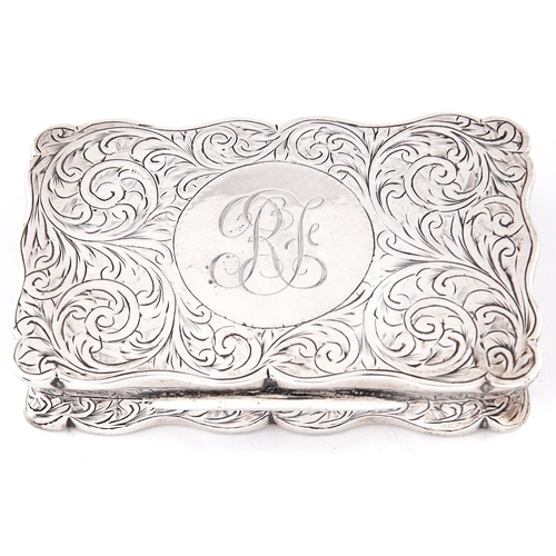 650a - An Edwardian silver snuff box, of scrolling outline with waisted sides and engraved with foliage, 75...