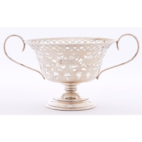 663 - A Victorian two handled pierced silver bonbon dish of vase shape, 14.5cm over handles, marks rubbed,...