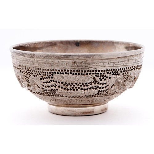 664 - A South East Asian cast and pierced silver dragons bowl, 20th c, with silver liner, the underside en...