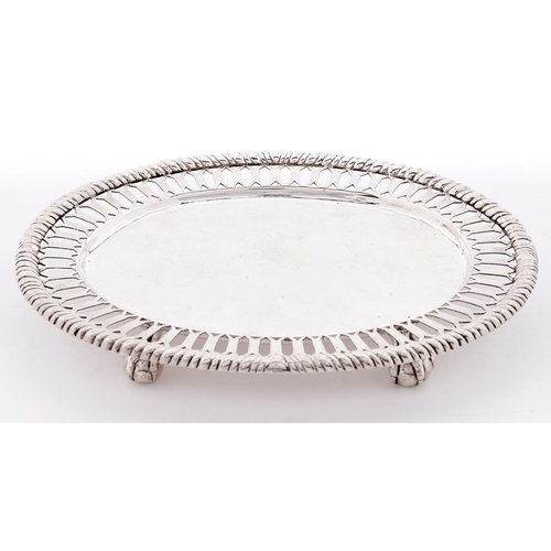 670 - A Victorian oval silver card tray, with pierced border and cable rim, on four claw and ball feet, 15...