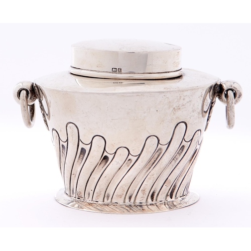677 - An Edwardian two handled oval silver tea caddy and cover, wrythen fluted, 7.5cm h, by W Hutton &...