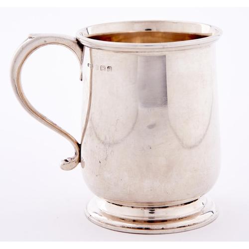 688 - A George V silver christening mug, 8cm h, by E S Barnsley & Co, Birmingham 1912, 4ozs 10dwts...