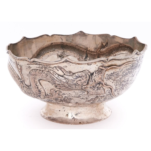 691 - A Chinese silver repousse dragon bowl, early 20th c, the dragon with applied silver wire whiskers on...