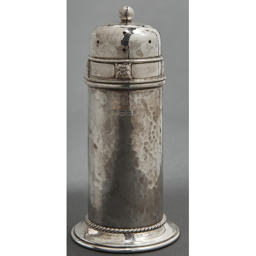 708 - A. E. Jones. An Arts and Crafts silver lighthouse caster and cover, hammer textured and applied with...