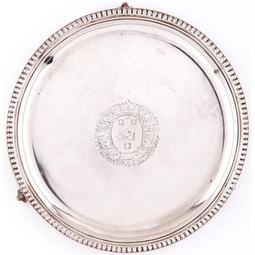 714 - A Victorian silver waiter, with plain cavetto and beaded rim, the field engraved with armorials and ...