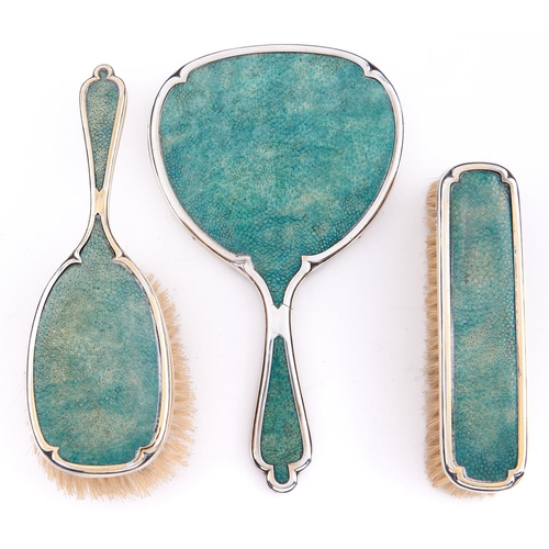 726 - A George V three piece silver gilt and shagreen brush set, hand mirror 24cm l, by William Comyns and...