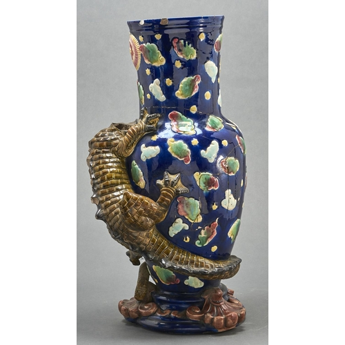 774 - A majolica dragon vase, late 19th c, the scaly olive green creature clinging to the blue vase, the f...