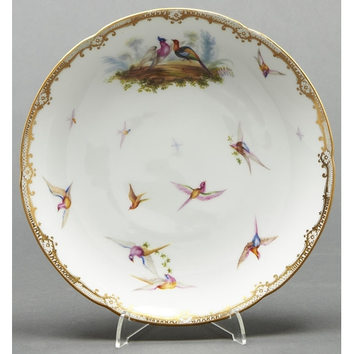 781 - An English porcelain dessert plate, c1860, painted in the manner of John Randall with birds, lobed g...